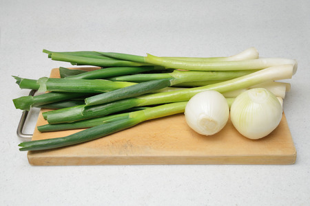 bulb and stem vegetables: closeup of cleaned onion and green onion
