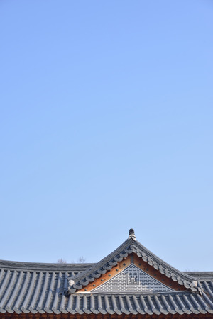 tiled roofs of Gyeongbokgung with clear sky in Seoul, Korea photo