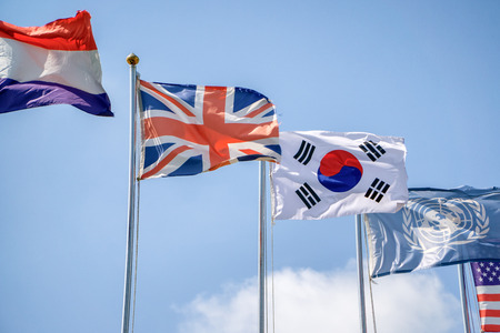 flags of Korea and the United Kingdom with others in sunny day photo