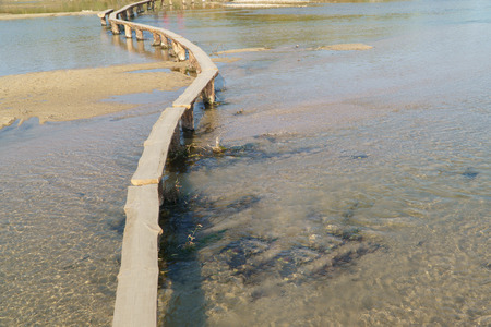 wood log: single lane log bridge over a shallow river in Museom Village, Yeongju, Korea. Stock Photo