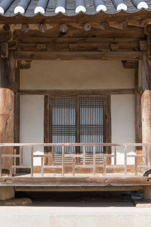 banister: front view of korean traditional architecture with door and baniser
