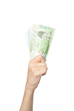 grasp: hand of putting korean bills up, isolated on white