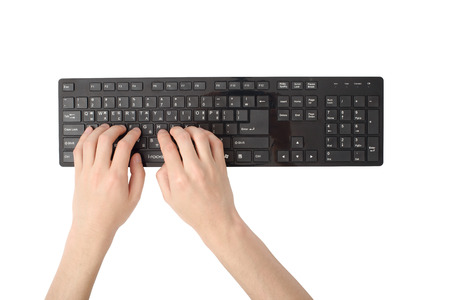 typing on computer: hands on a black keyboard, isolated on white