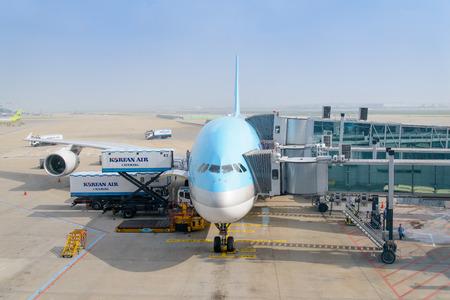 INCHEON, KOREA - JULY 29, 2013: Airplane of Korean Air, cargo is beding loaded.