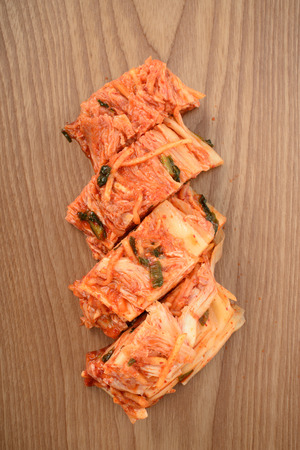 Cutted Gimchi, Korean traditional food, on a wooden plate photo