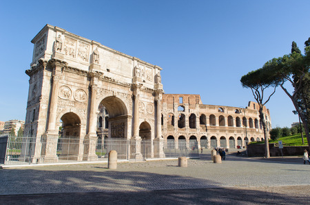 ROME, ITALY - JANUARY 21, 2010: Colosseum and Arch of Constantine in Rome, Italy. Colloseum of the largest amphitheatre in the world and the arch of constantine is the lastest existing triumphal arch in Rome. They are situated near the  foro romano.