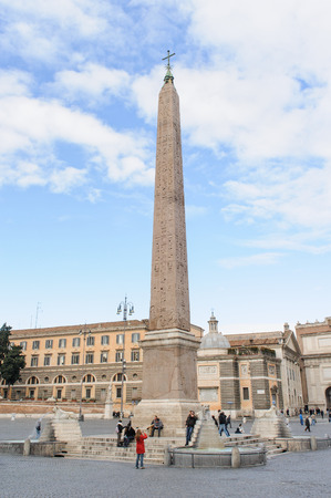 obelisco: ROME, ITALY - JANUARY 27, 2010: The obelisk is at the centre of the Piazza del Popolo in Rome, Italy. It is known as the obelisco Flaminio or the Popolo Obelisk. There are Egyptian style Lion fountains around the base of the obelisk,
