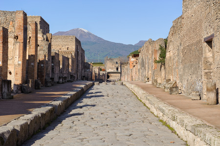 old street: Street view of the city of Pompeii in Campania, Italy. Pompeii is a ruin of acient Roman City near Naples in Italy. Stock Photo