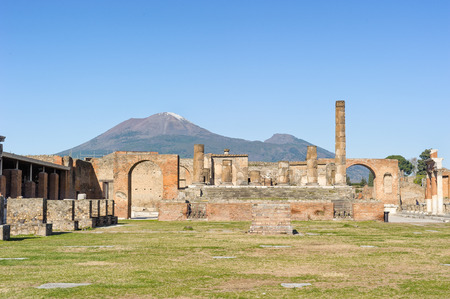 Ruined Temple of Jupiter with mount vesuvio in Pompeii. Pompeii is a ruin of acient Roman City near Naples in Italy. photo