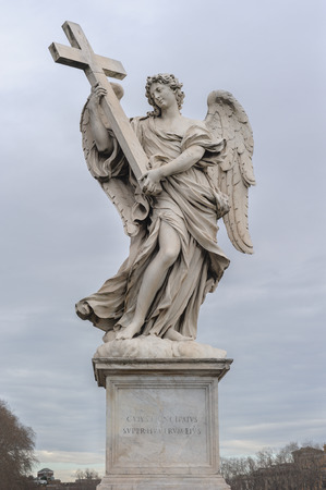 pons: Angel with the Cross is a statue on the Ponte SantAngelo in Rome, Italy. Ponte SantAngelo is a bridge in front of the Castel SantAngelo. Stock Photo