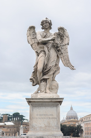 pons: Angel with the Crown of Thorns is a statue on the Ponte SantAngelo in Rome, Italy. Ponte SantAngelo is a bridge in front of the Castel SantAngelo. Stock Photo