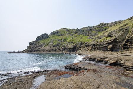 sedimentary: Yongmeori Coast(Dragon head coast), a tourist attraction famous for Multistory layered rough and strange sedimentary rocks in Jeju Island, Korea.