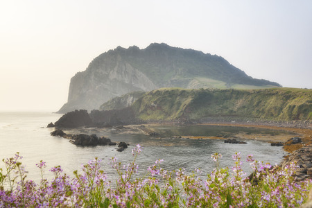 end of the trail: Landscape of Seongsan Ilchulbong, view from Olle trail No. 1 in a morning. Ilchulbong is a volcanic cone located on the eastern end of Jeju Island and it means the Sunrize peak.
