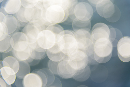 subdued: Background with soft delicate light circles made from water glow.