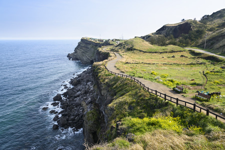 View of Olle walking path No. 10 Course in Songaksan in jeju island, Korea. Olle is famous trekking courses created along coast of Jeju Island. Songaksan is famous place for drama