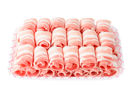 Plane Samgyeopsal, sliced frozen Pork belly meat. It is a popular Korean dish and consists of thick, fatty slices of pork belly meat. Isolated on white. Stock Photo