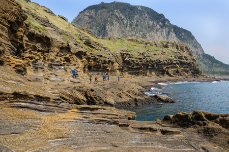 Jeju-do, Korea - April 11, 2015: Yongmeori beach  in Jeju Island is famous place for the majestic scenery by the sea and the seashore cliffs made of sandstone stacks. Yongmeori (means dragon head) comes from the shape of coast, looks as if a dragons head
