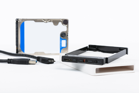 external hard disk drive: components of External Enclosure case and 2.5 inch Hard Disk Drive on a white background