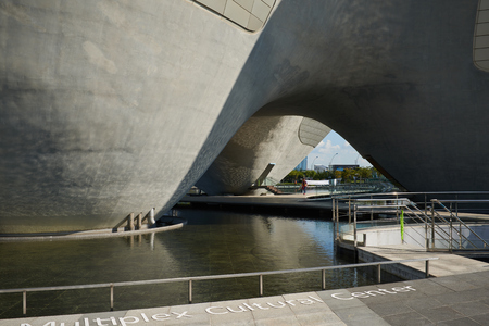Songdo, Korea - September 07, 2015: Tri-Bowl is a multi-purpose, integrated cultural arts space and It include an arena shaped performance space, education about culture and art as well as exhibits. The building is commissioned by the City of Incheon and