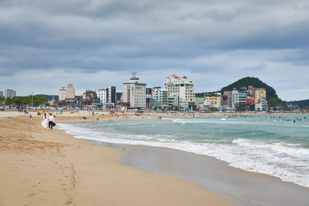 19 years: Busan, Korea - September 19, 2015: Songjeong is a beach located near the Haeundae beach in Busan. Songjeong beach has become famous for surfing place because of its clean white sand and good waves in recent years.