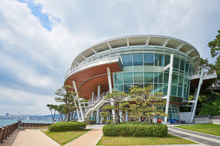 Busan, Korea - September 19, 2015: The Nurimaru APEC is located on Dongbaekseom island and built for the 2nd APEC Leaders meeting in 2005. The building has been used as a memorial hall and a prestigious international conference hall since the APEC summit