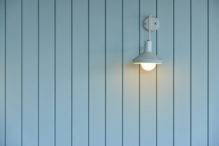 wood panel: wall made from wood panel painted blue and white lamp on the wall