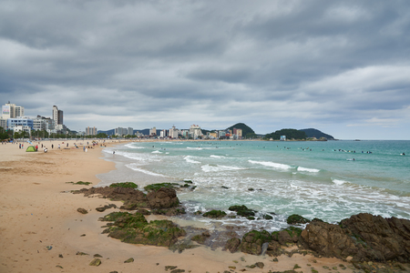 Landscape of Songjeong Beach. It is a beach located near the Haeundae beach in Busan and it has become famous for surfing place because of its clean white sand and good waves in recent years.