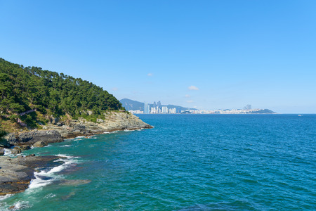 recently: Igidae park coastline and Haeundae district. Igidae park is a trail along the coast and It becomes famous for the beautiful scenery with Haeundae and Gwangalli in recently years. Stock Photo
