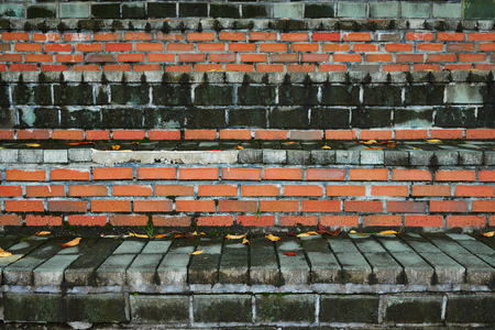 two tone: closeup of uneven old two tone brick stairs Stock Photo
