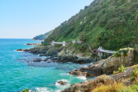 Landscape of Igidae coastline. Igidae park is a trail along the coast and It becomes famous for beautiful scenery with Haeundae and Gwangalli in recently years. Stock Photo