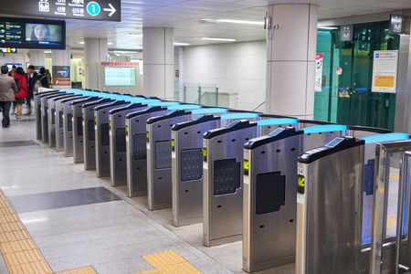 entrance gate: Seoul, Korea - December 9, 2015: ticket gate at City Hall subway station. The ticket barrier is a general gate type in most of subway in the city. Editorial