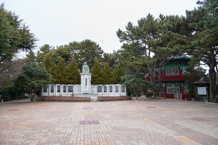 unified: Busan, Korea - January 22, 2016: Choi chiwon statue and historic building at Dongbaek park in Busan, Korea. Choi chiwon was a noted korean confucian official of the late unified Silla period.