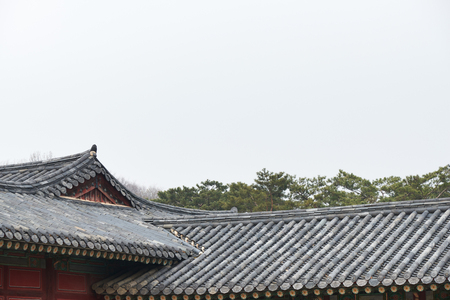 a traditional korean: Korean traditional tiled roofs in a palace Stock Photo