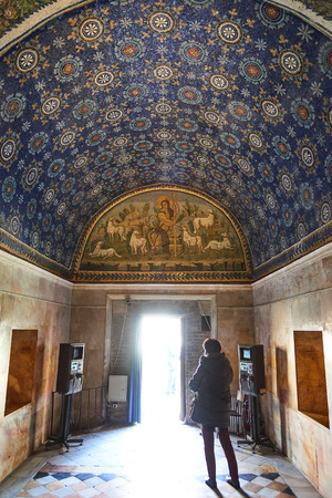 embellished: Ravenna, Italy - Febuary 18, 2016: Interior of Mausoleum of Galla Placidia, a Roman chapel embellished with colorful Roman mosaics in Ravenna. It was resignated as Unesco World Heritage. Editorial
