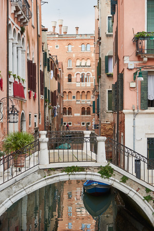 archtecture: Small bridge in Venice, a city in northeastern italy. It is famous for the beauty of its settings, archtecture and artwork. A part of Venice is resignated as a World Heritage site.