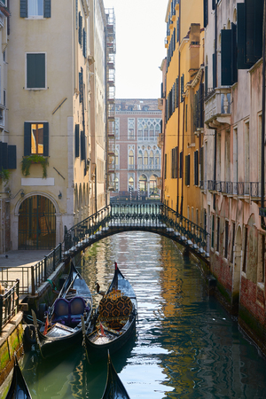 archtecture: Bridge and Gondola in Venice, a city in northeastern italy. It is famous for the beauty of its settings, archtecture and artwork. A part of Venice is resignated