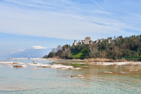 Grottoes of Catullus and Lake Garda in Sirmione which is a peninsula that divides the lower part of Lake Garda. It is a famous vacation place for a long time in northern Italy.