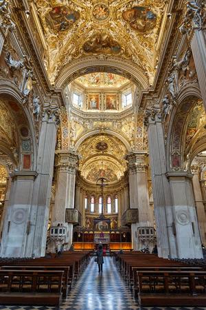 Bergamo, Italy - February 23, 2016: Interior of Basilica di Santa Maria Maggiore. The church is Romanesque architecture with a gilded interior hung with tapestries, built in 1137.