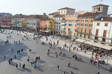 notable: Verona, Italy - Febuary 20, 2016: Piazza Bra, the largest piazza in Verona, Italy. The piazza is lined with numerous cafés and restaurants, with several notable buildings such as the Verona Arena. Editorial