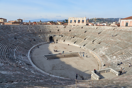 internationally: Verona, Italy - Febuary 20, 2016: Verona Arena, a Roman amphitheatre in Piazza Bra, built in 1st century. It is still in use today and internationally famous for the opera performances given there.