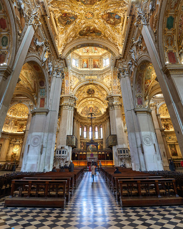 Bergamo, Italy - February 23, 2016: Interior of Basilica di Santa Maria Maggiore. The church is Romanesque architecture with a gilded interior hung with tapestries, built in 1137.