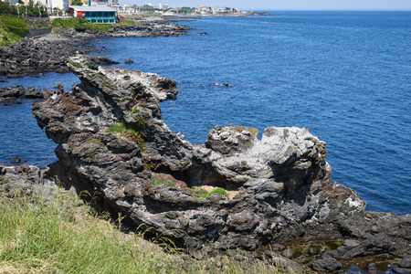 Yongduam Rock. Yongduam is a dragon head-like rock and one of the famous attraction near jeju city. It is situated to the north of Jeju city and was created by strong winds and waves.