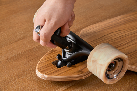 Adjusting the kingpin nut of the longboard for customizing carving