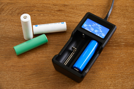 18650 Li-ion battery charging by premium charger  on a table