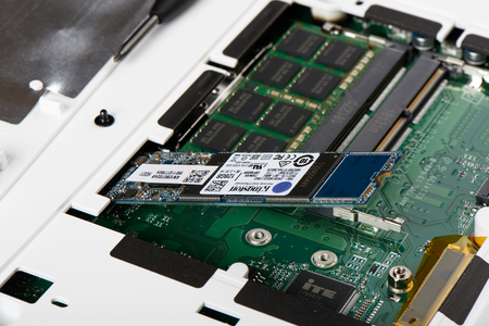 Gimpo-si, Korea - July 10, 2018: Closeup of SATA type SSD(Solid-State Drive) connected to M.2 slot on a board of laptop computer. Editorial