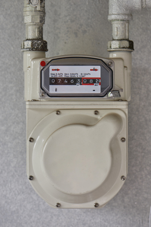 residential natural gas meter installed on a wall in a condominium in Korea
