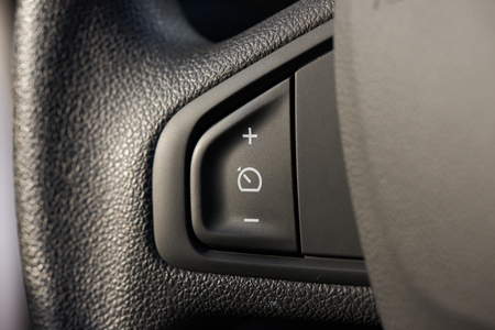Cruise control buttons to set speed, add speed and subtract Stockfoto