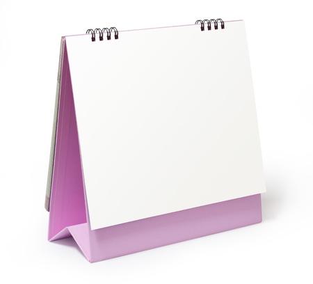 calendario escritorio: calendario en blanco de escritorio de color rosa sobre fondo blanco
