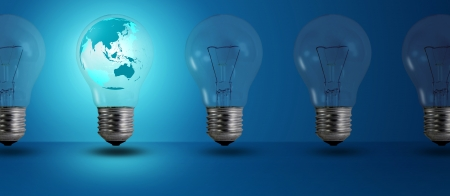 map inside glow among other light bulb on a blue background Stock Photo - 14245261