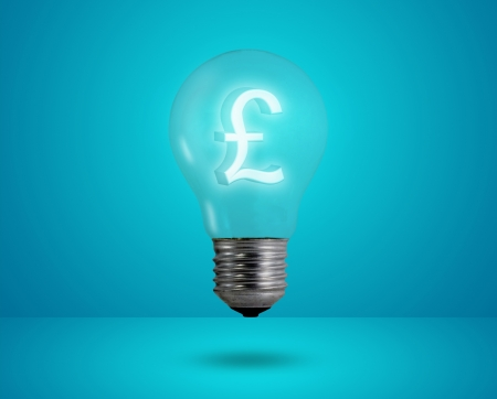 Money making idea. Light bulb with Pound symbol.  photo